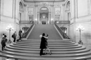 Leslie (aka Professor Woodhouse) and Edo married on the steps of SF City Hall in 2018;  Edo became Mr. Edo Castro-Woodhouse.